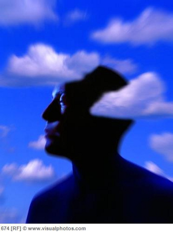 Silhouette of head with cloud background